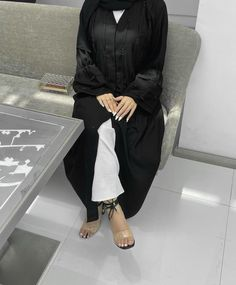Black Dubai Abaya Styles Inspo- Looking For The Latest Modern Dubai Black Abaya Styles, Then This Post Is For You, Latest 2021 Styles, Stylish Farasha Designs, Black Abaya Designs, Dubai Arab Swag, Abaya Design, Casual Abayas, Summer Abaya, Dubai Abayas, Latest Simple Black Abayas And Much More. #hijabfashion #abayadesigns #abaya #abayadubai #abayadress #hijaboutfit Hijab Fashion, Fashion Outfits, Instagram Influencer, Nice Dresses, Normcore, Casual, Black, Fashion Suits, Cute Dresses