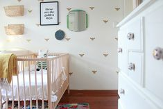 ::The Beetle Shack::: BABY BEETLESHACK ROOM TOUR  Love the bees! Stickers, not crazy $$ wallpaper. And all the yellow. And the crib is $100, ikea... And the rugs. And using wall hung baskets over the change table.