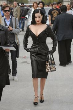 Dita Von Teese is ultra elegant in this Dior leather suit. literally everyone behind her is staring