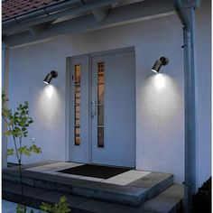 This single sleek solar light is an elegant addition to any landscaping. This LED unit adds a dash of style to your landscape while providing energy-efficient lighting. With no wiring required, you can easily install this maintenance-free solar light to illuminate and accent gardens, trees or signs. Equipped with a convenient rechargeable battery and a waterproof stainless-steel casting. Modern Exterior Lighting, Modern Landscape Lighting, Modern Exterior Doors, Modern Lighting, Lighting Ideas, Exterior Colors, Porch Light Fixtures, Exterior Light Fixtures, Exterior Wall Light