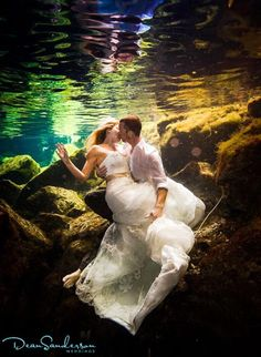 "Why We Love It: This underwater wedding photo is so dreamy!Why You Love It: Very creative, it reminds me of The Little Mermaid!"" —Raven M."