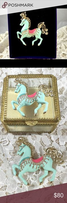 Bob Mackie Signed Aqua Carousel Horse Brooch Gorgeous carousel horse brooch in original box. Gold tone, aqua and pink enamel, and rhinestones. Bob Mackie Jewelry Brooches