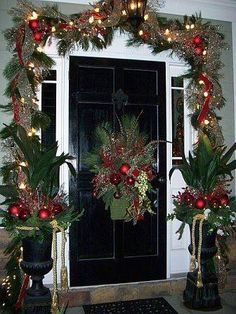 Red and gold garland around door & urn decorations
