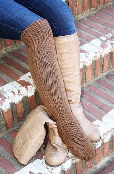 Deluxe Hand Knit Solid Color Long Alpaca Socks Funny and funky, yet functional. These deluxe solid color long alpaca socks will keep your feet and legs toasty on those cold winter days. This version of our deluxe sock comes in fashionable solid colors that both look and feel fantastic. Great around the house or inside of boots. Lightweight, hollow-fill structure makes alpaca fiber perfect for insulation! A great gift. www.purelyalpaca.com