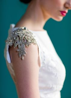 D.i.y. inspiration! repurposed lace, small silver beads & rhinestones. (Fabric paint if necessary) Sew onto shoulders of top/dress