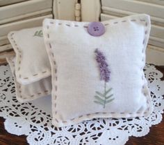 """sachet is made from linen and stitched with a lavender motif on the front. Each sachet is hand-stitched and varies slightly with a different lavender button. The sachet is 4"""" by 4"""", and filled with approx. 3/4 cup of lavender"""
