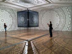 Pakistani American artist Anila Quayyum Agha. Intersections, Laser-cut Wood, Single Light Bulb, 6.5' Square Cube, Completed: December 2013, Cast Shadows: 32'x34'.