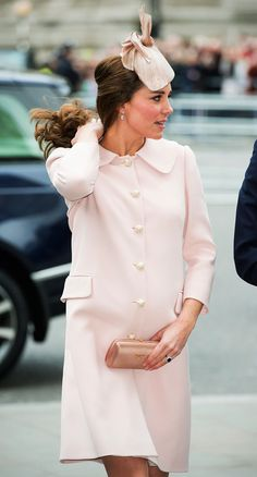 <strong>MARCH 2015.</strong> It's easy to forget (and also more fun to forget!) that Kate's hair does not just <em>appear</em> the way it is, with no handling or care or attention. The Duchess must, on occasion, make adjustments.