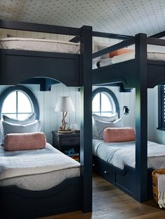 Navy Bunksets with Oval Windows l Coastal Bedrooms & Baths l www.DreamBuildersOBX.com