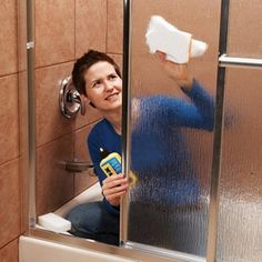 how to keep shower doors clean - use RainX to repell water!  Genius!