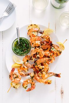 Recipe: Grilled Shrimp Skewers with Chimichurri   If you're looking for something other than chicken and burgers to grill, shrimp is the answer. When grilled with an herby, garlicky chimichurri sauce that doubles as both a marinade and a dipping sauce, shrimp skewers have enough bold flavor with only five minutes on the grill to cook. Serve them for dinner on a busy weeknight or as a fast and fancy appetizer at your next grilling party.