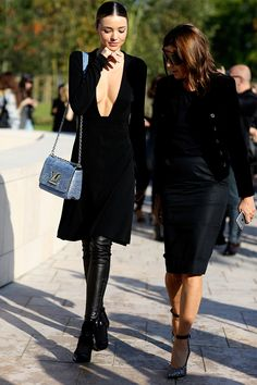 How low can you go? #MirandaKerr daring as always, and #CarineRoitfeld goes in for the peak. It's fashion week, Paris.