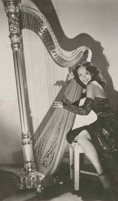 """vintageblackglamour: """"Olivette Miller, celebrated """"swing"""" harpist of the 1940s, was born 101 years ago today (February 2, 1914) in Illinois. Here parents were Bessie Oliver Miller, a 1900's chorus... Vintage Black Glamour, Vintage Beauty, Women In History, Black History, Look At You, Beautiful Black Women, Beautiful Gowns, Black People, Cello"""