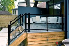 Cool Modern Home Exterior Design With White Accent Furniture Over Front Porch Wooden Raised Deck As The Front Porch Using Metal Glass Porch Railing Ideas. Exemplary Images Of Porch Railing Ideas. Deck Railing Design, Glass Railing, Front Porch Railings, Deck Railings, Cable Railing, Modern Front Porches, Glass Porch, Glass Roof, Aluminum Decking