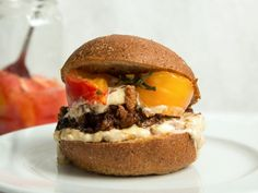 Piri Piri Fried Chicken Sandwiches | This best ever Piri Piri Fried Chicken Sandwiches recipe gets flavor from bird's eye chiles, ginger and garlic. Get the recipe from Food & Wine.