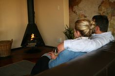 Relaxing in front of the fireplace with a glass of wine at 3@Marion Guesthouse