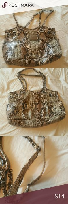 Snakeskin Nicole hobo. Or tote. I love this purse. It's a great size and it's nearly indestructible.  I am keeping it's black/gray cousin, but I am using my new posh addiction to clean out excess. The handle grips show some wear. So I tried to make the price too good to miss. Nicole by Nicole Miller Bags Hobos