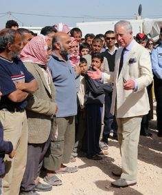 Prince Charles of Wales meets Syrian refugees in the King Abdullah Refugee Camp, 2 kilometers from the Syrian border on 13 Mar 2013 in Amman