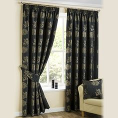 Pencil pleat curtains with a golden floral patterned set off on a purple background