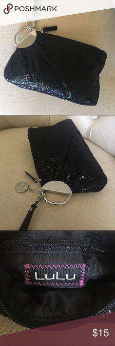 "LuLu Black wristlet Stunning wristlet black with silver hardware. 8""W X 5 1/2"" H. Detachable strap. Black faux snake skin material. EUC Lulu Bags Clutches & Wristlets"
