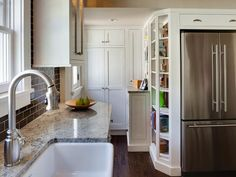 Supersize the look of your small kitchen! Design experts at HGTV.com offer eight easy-to-execute kitchen design ideas for small kitchens.