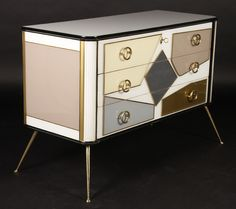 """A stylish Italian three drawer commode decorated with multicolored glass of geometric forms with bronze ring pulls and bronze legs.   $ 2,000/$ 3,000   Dimensions: Ht: 32 1/2"""" Width: 47 1/2"""" Depth: 19 1/2"""""""