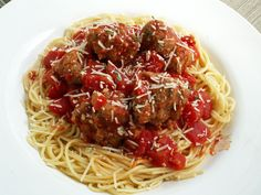 The meatballs are quite common in Italy, but not on pasta with sauce, except in some grandma's recipes, or in some specific areas.