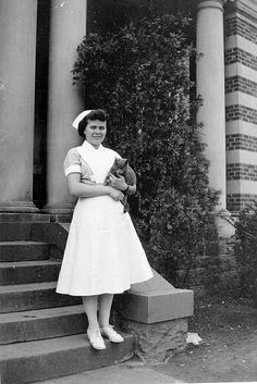 Polly Schmidt and her pet cat while she lived and trained at Philadelphia State Hospital (Byberry) during WWII. She was a cadet nurse, part of the US Cadet Nurse Corps program.