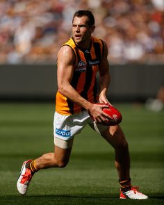 2015 Toyota AFL Grand Final - Hawthorn v West Coast - Luke Hodge of the Hawks in action during the 2015 Toyota AFL Grand Final match between the Hawthorn Hawks and the West Coast Eagles at the Melbourne Cricket Ground, Melbourne, Australia on October 3, 2015.