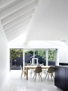 Dove House | Gundry & Ducker  An extension to a Victorian terraced house. A formerly dark and narrow kitchen area was transformed into a light filled kitchen and family room. The ground floor was expanded sideways into an unused yard area and backwards into an area previously occupied by an outside WC.