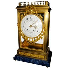 Antique French Louis XVI Doré Bronze Clock w/ Lapis Lazuli Base | From a unique collection of antique and modern clocks at https://www.1stdibs.com/furniture/more-furniture-collectibles/clocks/