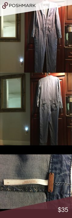 Free People Lou Blue Denim Jumpsuit This faded chambray FP jumpsuit has a lived in look. Fabric is a very soft chambray. Belt is missing and asking price reflects this. Size is 0 but can fit up to a 2 and still have that loose look. Last photo is a stock photo to give you a better idea of how it looks on. No flaws that I am aware of other than missing belt Free People Other