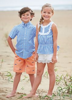 Gingham button down and shark motif salmon-colored shorts for Ty