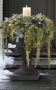 Winter decor Create the magic of a winter forest with this lifelike greenery collection. Cypress, silver dollar leaves and hemlock tips mingle with pine cones, white berries and silver berries, all finished with a subtle dusting of snow.