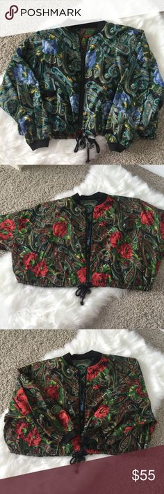 Vintage Floral Paisley Boxy Oversized Crop Jacket This jacket is super unique and beautiful! It is reversible! One side is red, green and the other side is blue, yellow (this side has pockets). There is not a tag or size so go based on measurements, please. Length is 19 1/2in, waist is 31in, armpit to armpit is 34in (one side, laying flat), shoulder to shoulder is 20 1/2 in. In great condition, only bit of wear on the tassels. There are shoulder pads and one of them is bunched on one side…