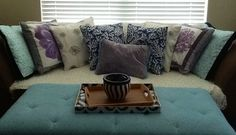 Coming together... Toss #pillows #ottoman hand painted purple flower pillows, modern comfy chic apartment living #LaneOriginal