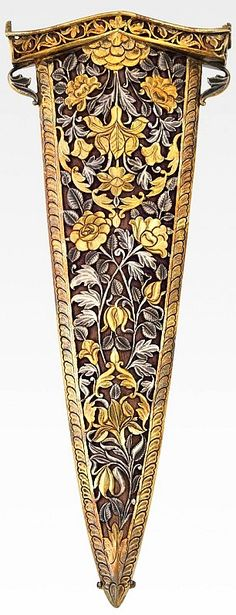 Indian katar scabbard, 18th century, North India, probably Lucknow, Uttar Pradesh, gilded silver pierced metal work, velvet, wood, 9¾ x 3 11/16 x 13/16 in ()24.77 x 9.37 x 2.06 cm, Virginia Museum of Fine Arts.