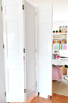 "Studioffice: Craft Room Tour photo by Diane at In My Own Style. Love the door on wheels so you can hide the ""mess"" you may have behind the doors."