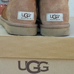 UGG Boots These are UGG Bailey button boots in light  Chestnut.   They have slight water stain in front part of boots, but are in really good condition.   Comes in original box that is ripped, but is still good to store boots. UGG Shoes Winter & Rain Boots