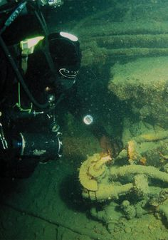 Deep inside Lusitania's holds, divers find all manner of machinery and cargo still lashed into position.
