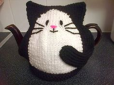knitted black cat tea cosy