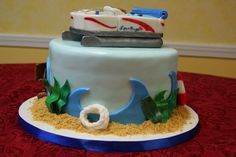 Pontoon Boat Cake Pontoon boat made of gumpaste and fondant. Lake Cake, Boat Cake, Pontoons, Pontoon Boat, Gum Paste, Fondant, Cookies, Desserts, Crack Crackers