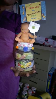 its a candy jar as a baby sprinkle return gift