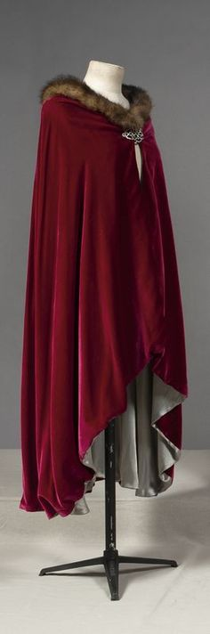 This is the cape I would use for little red minus the fur around the collar. I like the darker, deeper hue, as it goes better with the blue dress. The length is medium because so it will not get in the way.