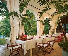 Ralph Lauren safari lunch.  Love the potted palm trees and outdoor curtains.