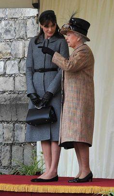Au Revoir to France's glam first lady Carla Bruni-Sarkozy - wearing Christian Dior.
