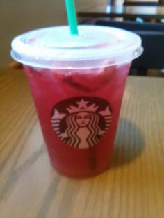 Starbucks Strawberry Acai` Refresher :-P Try it with Passion Tea instead of water. Delicious Strawberry Acai` Passion deliciousness....