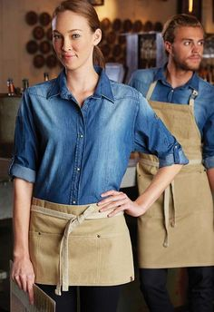 Ready for a new restaurant uniform look for your servers, waiters, chefs and kitchen? Our uniform idea consultants are here to help-free advice-free samples Cafe Uniform, Waiter Uniform, Hotel Uniform, Waist Apron, Apron Dress, Kellner Uniform, Waitress Outfit, Indigo Dress, Restaurant Uniforms