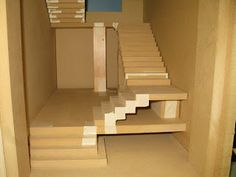Staircase building. Great pics and tutorial of how she made these stairs.