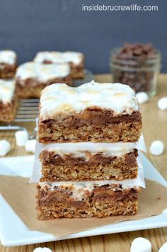 Oatmeal S'mores Bars | Inside BruCrew Life - oatmeal cookie bars topped with chocolate chips, mini marshmallows, and Reese's peanut butter c...